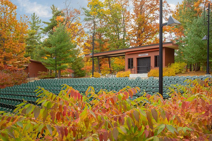 An outdoor amphitheater ablaze with fall color
