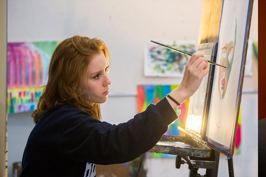 Student paints during interlochen arts camp
