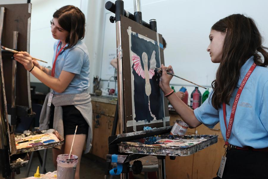 Two students paint during class at interlochen arts camp