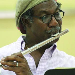 A man plays the flute